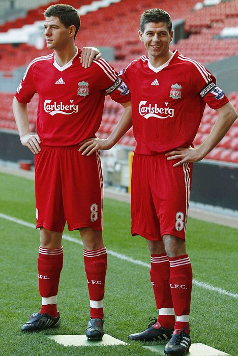 Liverpool captain Gerrard smiles as he comes face to face with his wax figure in Liverpool